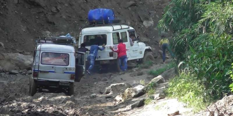 Locals of Panchthar pushing vehicles stuck in a muddy road in this recent photo. The people of this region have volunteered to mend the roads keeping in mind flow of vehicles during the  Dashain festival. Photo: Khabin Luitel/NBA