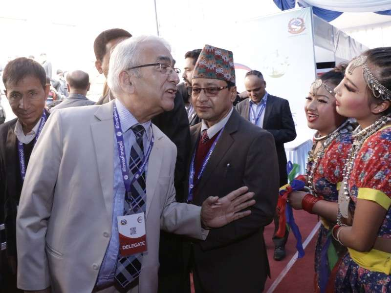 Dr Bhola Rijal interacts with 'panchakanyas' during the Nepal Investment Summit. Photo: NBA